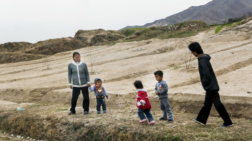 A family of North Koreans. Shai's itinerary was strictly controlled but he photographed people's daily life when possible. (Moshe Shai)