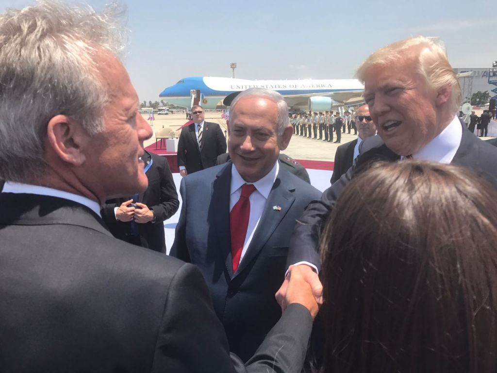 Arriving in Israel, US President Donald Trump shakes hands with former US ambassador to the US, Deputy minister Michael Oren MK, at Ben-Gurion Airport on May 21, 2017 (Courtesy)
