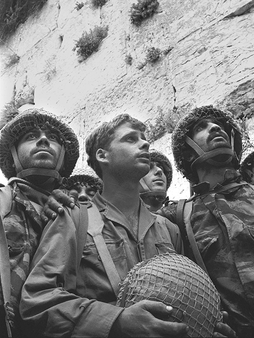 From left, Israeli paratroopers Tzion Karasenti, Yitzhak Yifat and Chaim Oshri stand at the Western Wall after Israel captured the Temple Mount in Jerusalem on June 7, 1967.