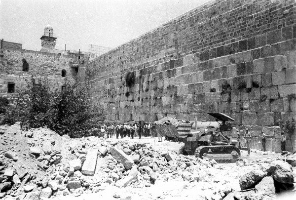 Bulldozers clear the rubble of houses nearest to the Western Wall, June 11, 1967. (From the collection of Dan Hadani, National Library of Israel).
