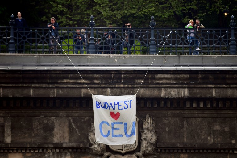 This photo taken on April 9, 2017 shows a banner hanging over the Budapest tunnel, as students and teachers of the George Soros-founded Central European University protest in Budapest with their sympathizers. (AFP PHOTO / ATTILA KISBENEDEK)