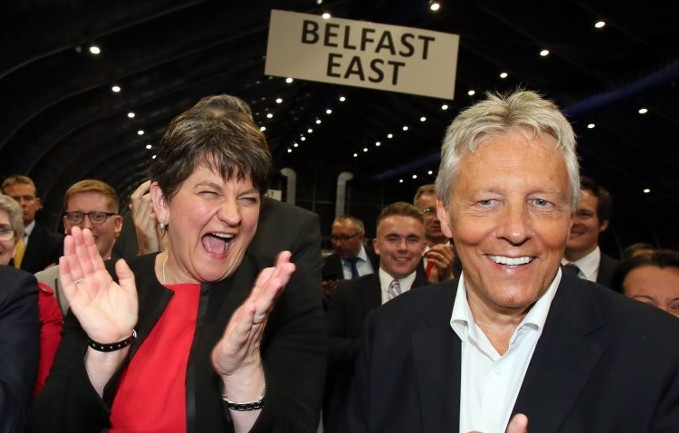 Democratic Unionist Party leader Arlene Foster left celebrates with Former Democratic Unionist Party Leader Peter Robinson at the counting centre in Belfast Northern Ireland early in the morning