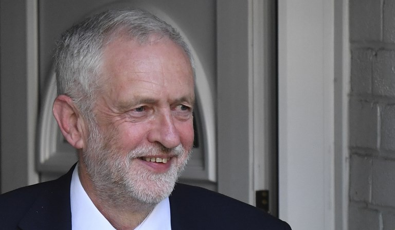 Britain's opposition Labour party Leader Jeremy Corbyn reacts as he leaves his home in north London on June 9, 2017 after results in a snap general election suggest a hung parliament eliminating the Conservative majority (AFP PHOTO / Ben STANSALL)