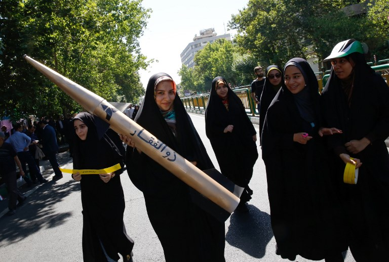 An Iranian girl holds a model of a missile during a rally marking al-Quds (Jerusalem) Day in Tehran on June 23, 2017. (AFP PHOTO / Stringer)