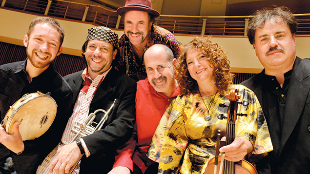 The Klezmatics; Frank London, second from left, holds his trumpet.