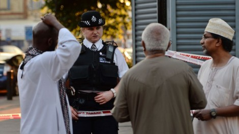 A police officer talks to local people at Finsbury Park in north London, where one man has died, eight people taken to hospital and a person arrested after a van struck pedestrians. PRESS ASSOCIATION Photo. Picture date: Monday June 19, 2017. See PA story POLICE SevenSisters. Photo credit should read: Victoria Jones/PA Wire