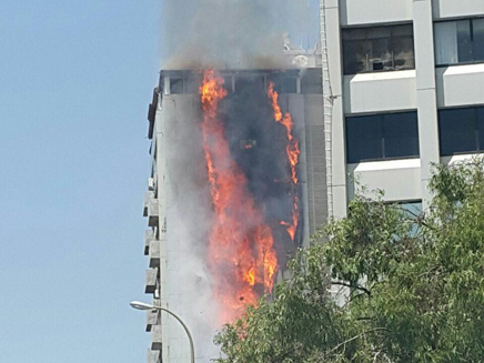 A fire rages in a 15-story apartment building in Ramat Gan, June 13, 2016. (Screen capture: Channel 2)