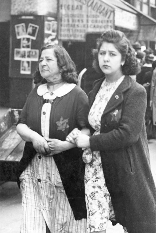 Women in Paris with a yellow star on their clothes marking them out as Jews