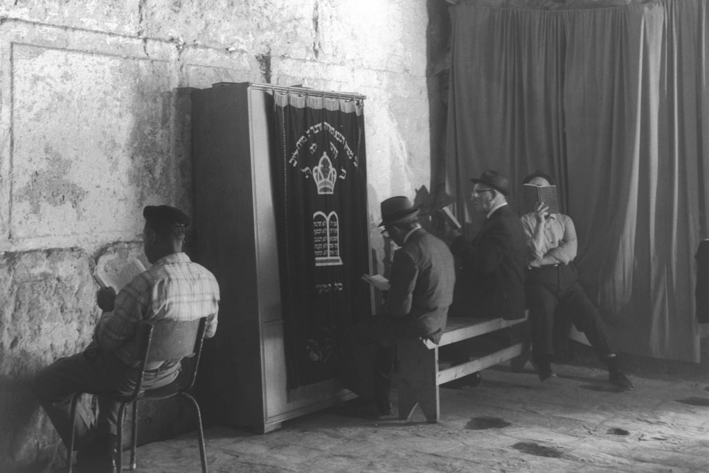 Jewish men praying new an ark containing Torah scrolls at Wilson's Arch in Jerusalem's Old City, circa 1970. (Moshe Milner/GPO)