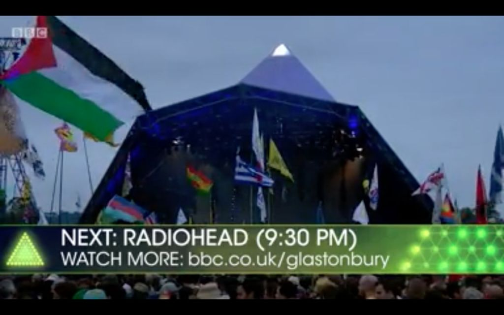 A Palestinian flag flutters as Radiohead take to the stage