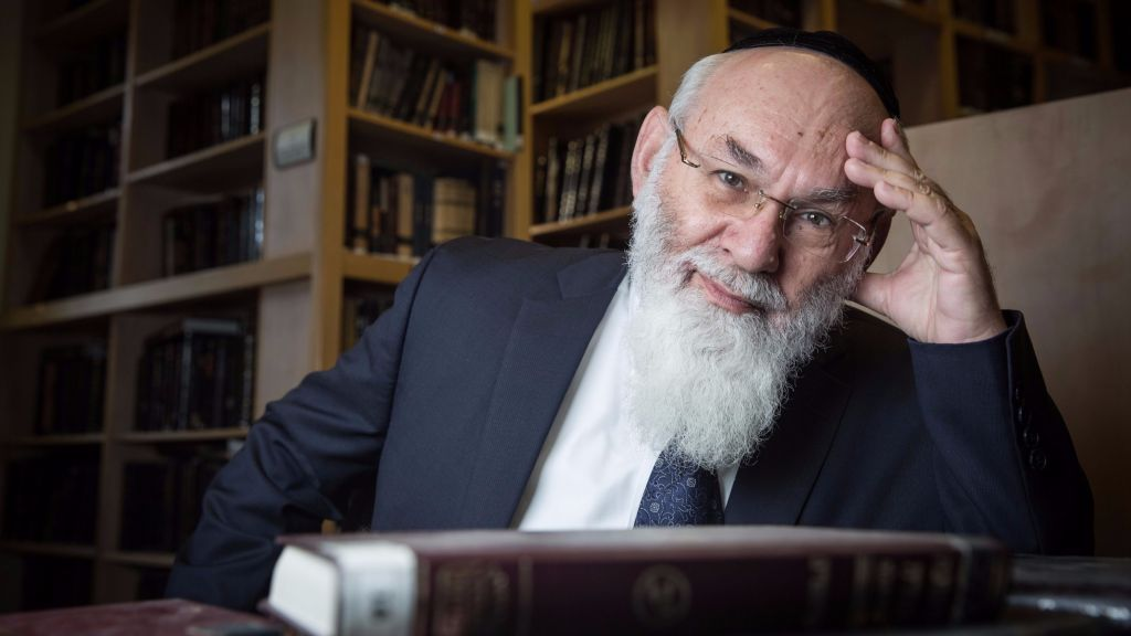 Portrait of Professor Avraham Steinberg, in charge of the Talmudic Encyclopedia publishing house, at the library in Jerusalem, on December 27, 2015. (Hadas Parush/Flash90)