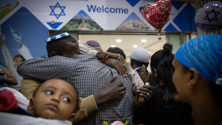 Family members greet new arrivals from Ethiopia at Ben Gurion Airport on June 6, 2017. (Miriam Alster/Flash90)