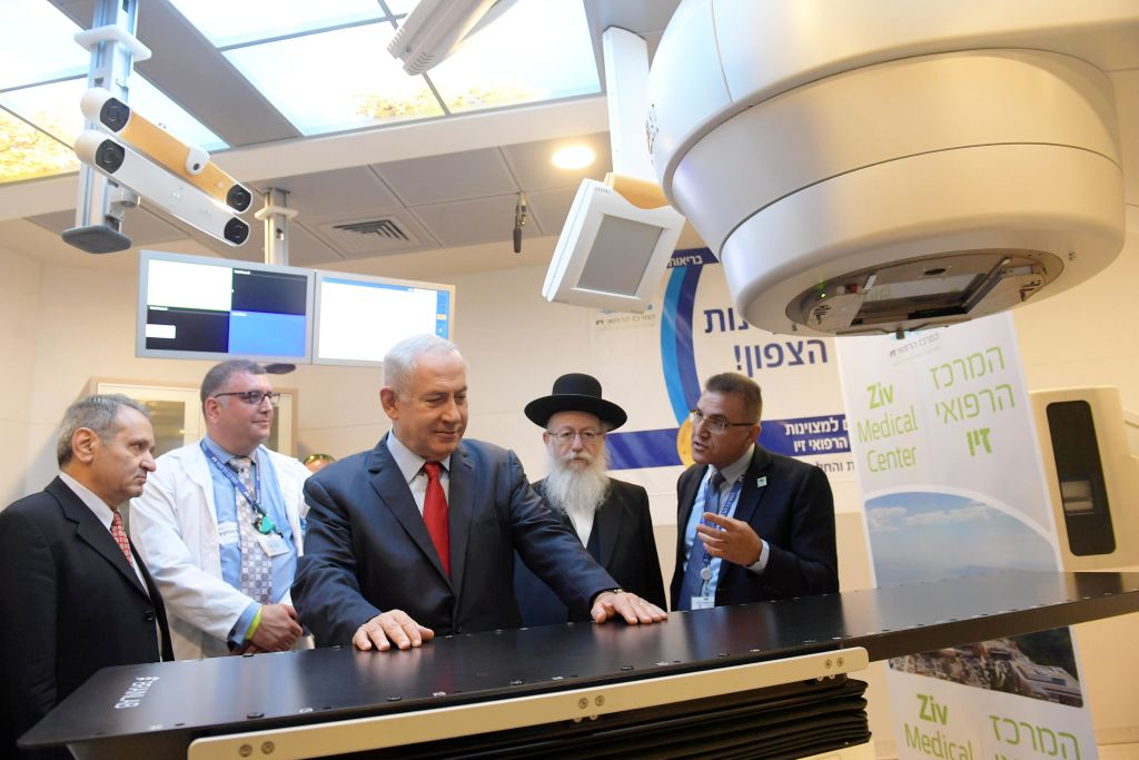 Prime Minister Benjamin Netanyahu and Health Minister Yaakov Litzman attend the opening of a radiotherapy department the first of its kind in the north at the Ziv Medical Center in Safed Israel
