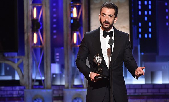 "Michael Aronov accepts the award for Best Performance by an Actor in a Featured Role in a Play for ""Oslo"" onstage during the 2017 Tony Awards at Radio City Music Hall on June 11, 2017 in New York City."