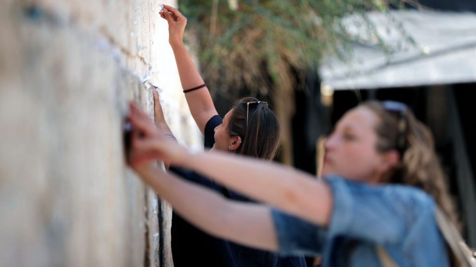 Women pray at the women's section of the Western Wall. Getty Images