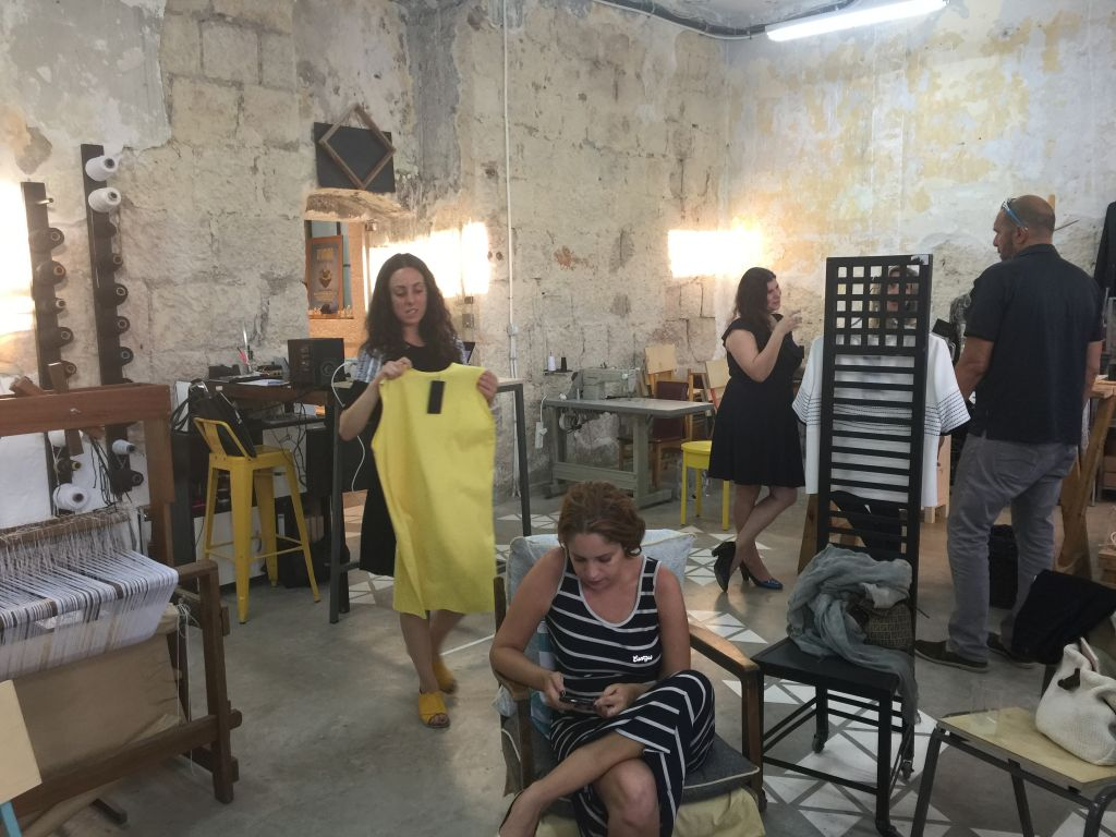 Adi Yair's loom and handwoven designs in the third corner of the Parallel studio (Jessica Steinberg/Times of Israel)
