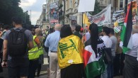 Pro-Palestine supporters draped in Hezbollah flags at Sunday's Al Quds Day march