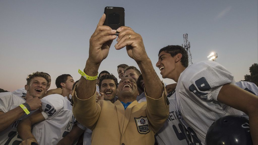 In this Thursday, June 15, 2017 photo, former NFL player Aeneas Williams takes selfie with an Israeli football player in Ramat Hasharon, near Tel Aviv, Israel. (AP Photo/Tsafrir Abayov)