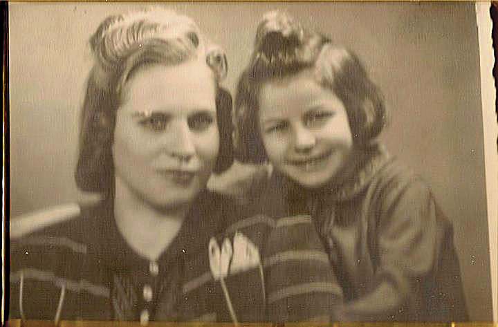Sarah and her protective nanny, Victoria, in Poland after the war ended.