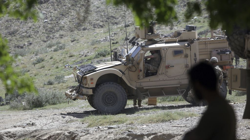 In this April 17, 2017 photo, US forces and Afghan security police are seen in Asad Khil near the site of a US bombing in the Achin district of Jalalabad, east of Kabul, Afghanistan. (AP Photo/Rahmat Gul)