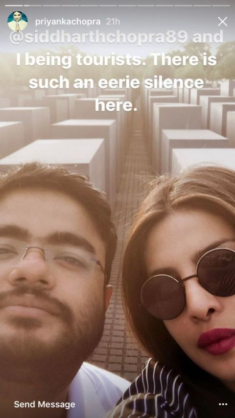 Priyanka Chopra and her brother posing for a Shoah memorial selfie