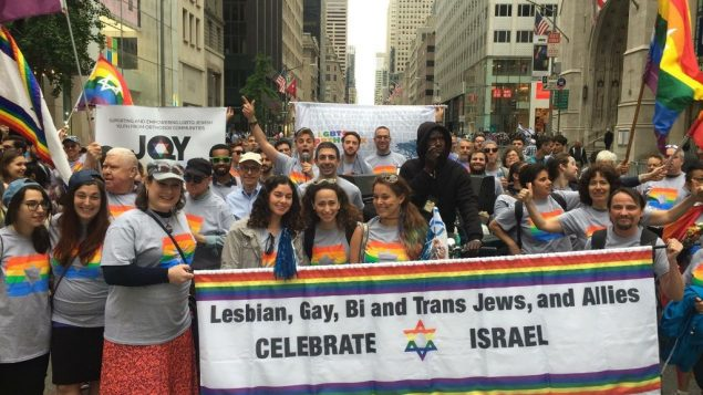 Participants march with the Jewish Queer Youth banner. Courtesy of JQY