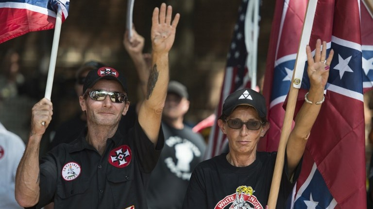 Members of the Ku Klux Klan gesture during a rally in Charlottesville, Virginia on July 8, 2017. (AFP Photo/Andrew Caballero-Reynolds)