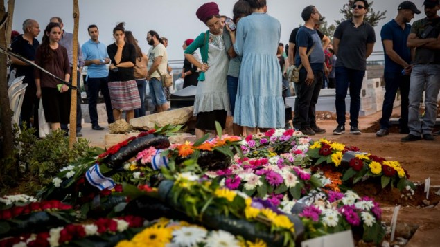 Friends and relatives mourn at the graves of Yosef Salomon (70), his daughter Haya (46) and son Elad (35), after their funeral, attended by thousands, at the Modiin Cemetery, on July 23, 2017.    Photo by: JINIPIX