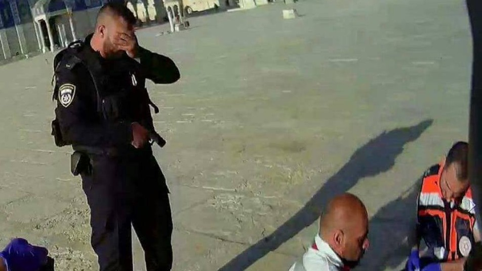 An Israeli police officer cries as paramedics try to resuscitate one of two cops shot in a terror attack on the Temple Mount Friday July 14 2017. The two officers dies of their wounds