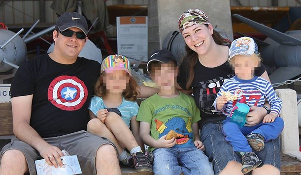 Elad Salomon, left, with his wife Michal and three of their kids. Elad was stabbed to death on July 21, 2017 in a terrorist attack at Halamish. (Courtesy)