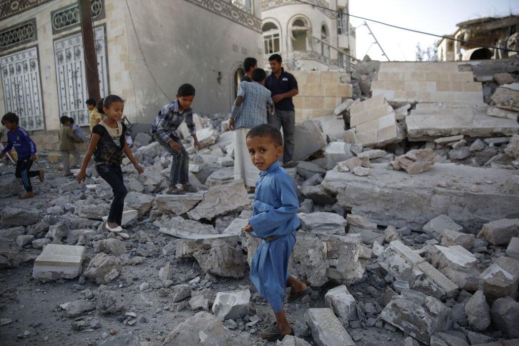 Children play amid the rubble of a house destroyed by a Saudi-led airstrike in Sanaa, Yemen, September 8, 2015. (AP Photo/Hani Mohammed, File)