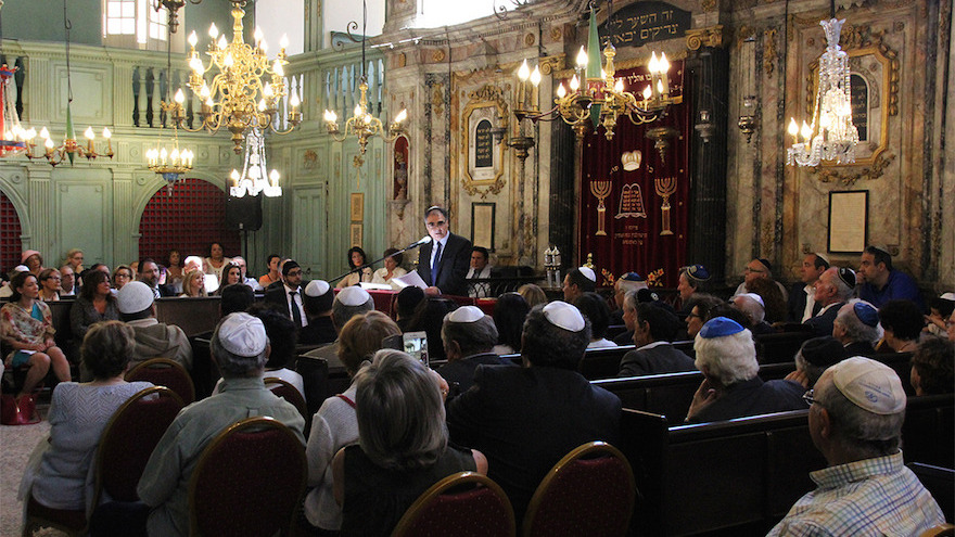 Meyer Benzecrit, the president of the Jewish community of Carpentras, delivering a speech at the town's synagogue, May 28, 2017. (Courtesy of the municipality of Carpentras/via JTA)