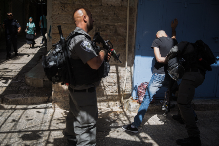 Border Police officers frisk a young Palestinian in Jerusalem's Old City after a deadly terror attack took place near the Temple Mount complex, in which three Arab Israeli gunmen shot and killed two Israeli police officers, on July 14, 2017. (Hadas Parush/FLASH90)