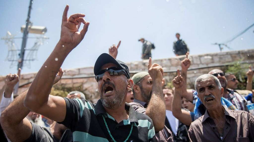 Muslim protesters demonstrate outside the Old City of Jerusalem's Lions Gate on July 19, 2017. (Yonatan Sindel/Flash90)