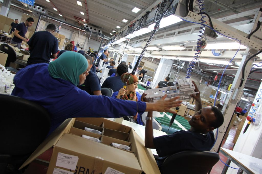 Israeli and Palestinian workers, working together