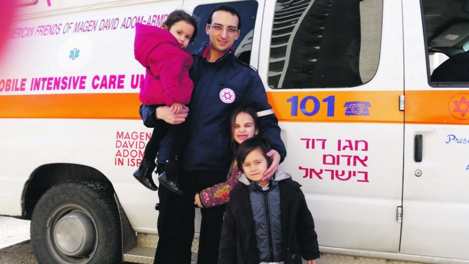 Nathan Levy with his MDA ambulance and three of his four children.