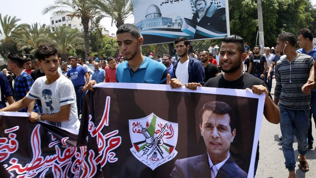 Hundreds of supporters of exiled former Gaza strongman Mohammed Dahlan carry a banner with his picture during a protest in Gaza City on July 20, 2017. (AP Photo/Adel Hana)