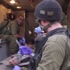 Israeli soldiers delivering aid and assistance to Syrians