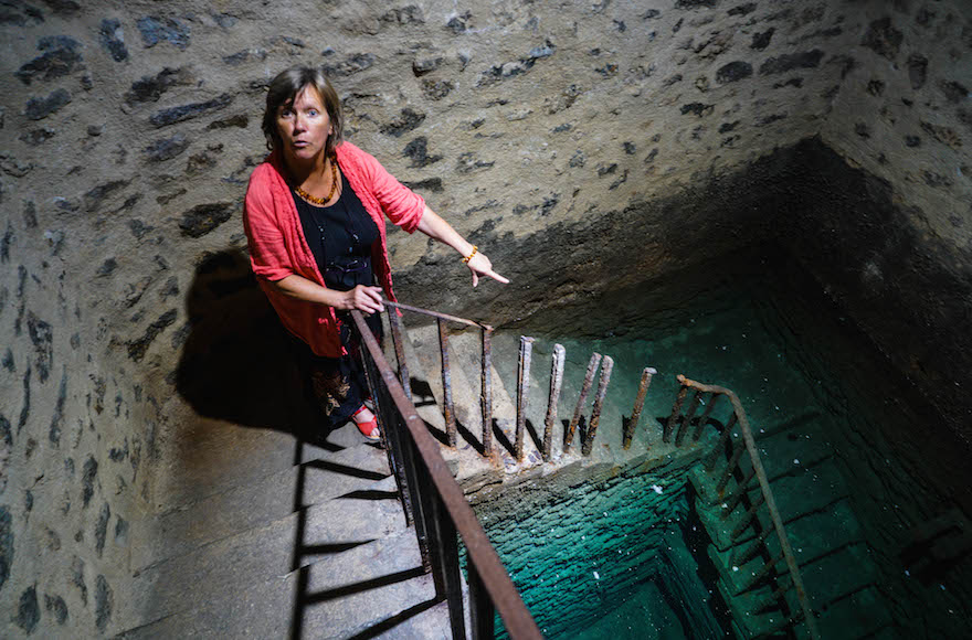 Françoise Richez talking about the ritual bath, or mikvah, of the Jewish community of Carpentras, July 7, 2017. (Cnaan Liphshiz/JTA)