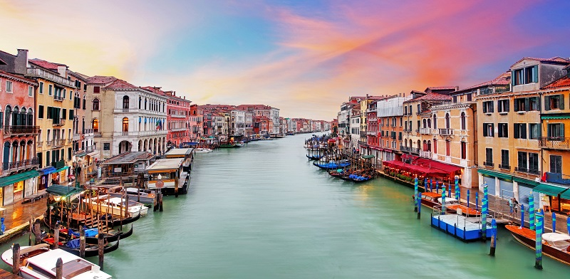 Venice Grand Canal gondolas, at sunset from Rialto Bridge