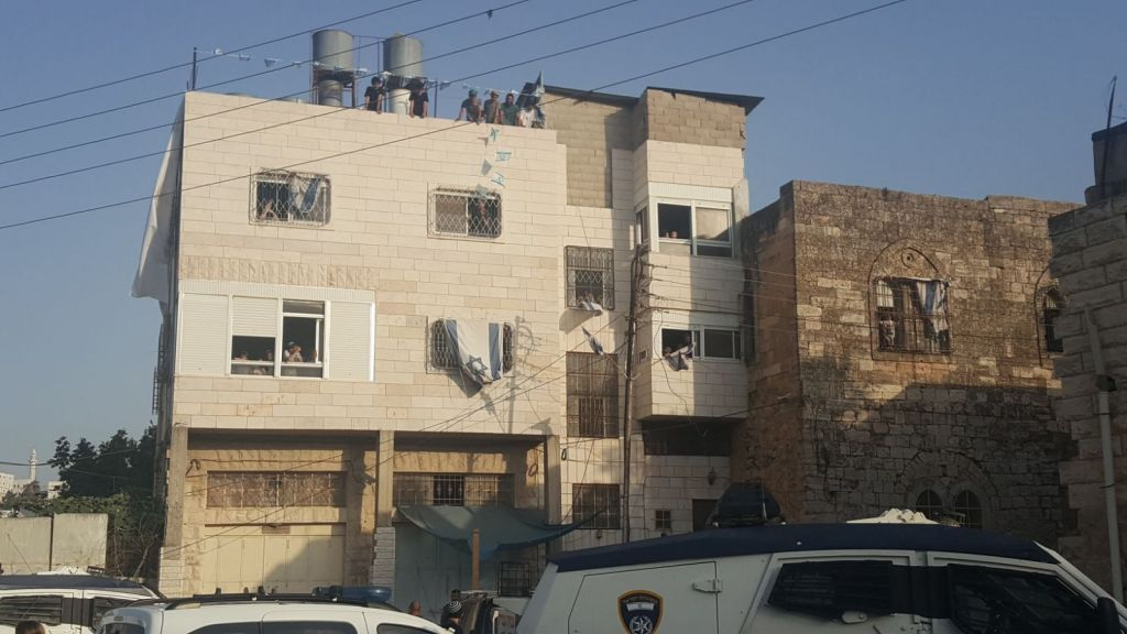 At least 15 Jewish families move into disputed West Bank building