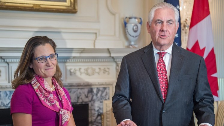Canadian Minister of Foreign Affairs Chrystia Freeland (L) listens as US Secretary of State Rex Tillerson talks about Charolettsville violence during a private meeting at the US Department of State in Washington, DC on August 16, 2017. (AFP Photo/Paul J. Richards)