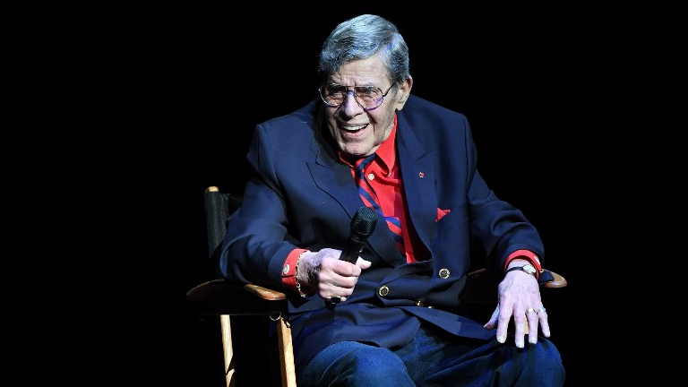 Entertainer Jerry Lewis smiles as he speaks during Criss Angel's HELP (Heal Every Life Possible) charity event at the Luxor Hotel and Casino benefiting pediatric cancer research and treatment on September 12, 2016 in Las Vegas, Nevada. (Ethan Miller/Getty Images/AFP Ethan Miller)