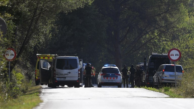 Spanish policemen and sappers arrive at the site where Moroccan suspect Younes Abouyaaqoub was shot on August 21, 2017, near Sant Sadurni d'Anoia. (AFP Photo/Lluis Gene)