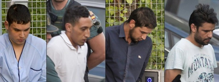 This combination of pictures created on August 22, 2017 shows (from L) Mohamed Houli Chemlal, Driss Oukabir, Salah El Karib, and Mohamed Aallaa, suspected of involvement in the terror cell that carried out twin attacks in Barcelona and Cambrils, at a detention center in Tres Cantos, near Madrid, on August 22, 2017, before being transferred to the National Court. (AFP Photo/Stringer)