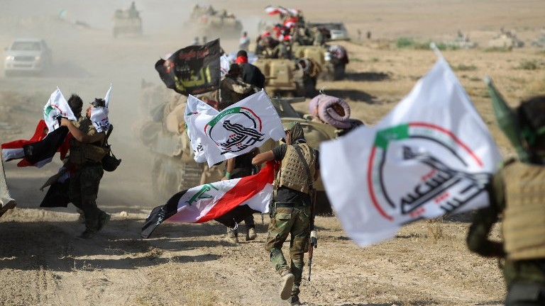 Fighters from the Iraqi Popular Mobilization Forces advance towards the town of Tal Afar on August 22, 2017. (AFP Photo/Ahmad al-Rubaye)