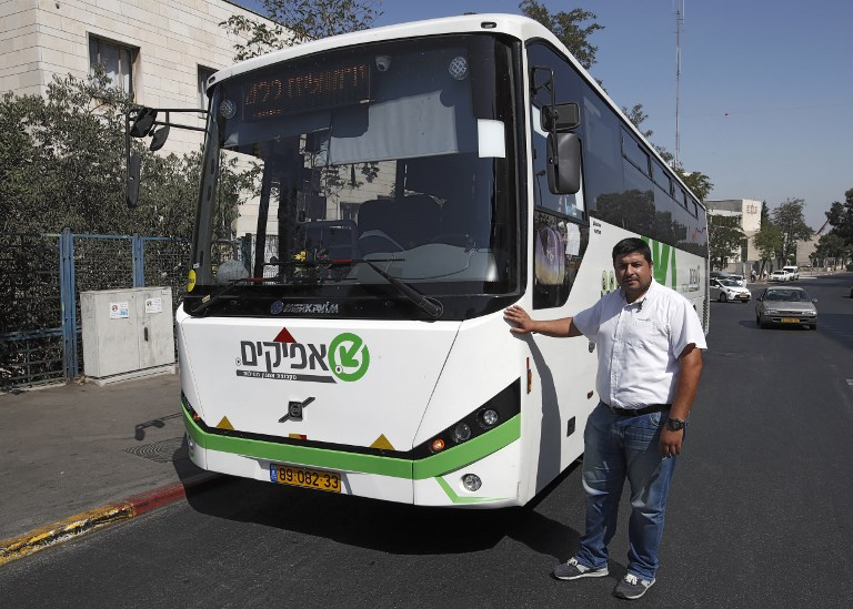 East Jerusalem Palestinian bus driver Ramadan Jamjoum poses on August 24, 2017 after he returned $10,000 to a Jewish man who left it in his vehicle. The passenger had forgotten the cash in Bnei Brak, a city near Tel Aviv dominated by ultra-Orthodox Jews. (AFP PHOTO / AHMAD GHARABLI)