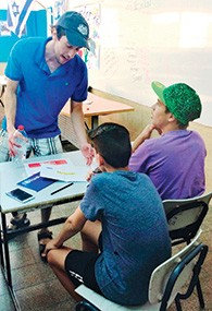 Michael Elbaz of Teaneck discusses an  English assignment with campers in Counterpoint's summer camp in Arad.