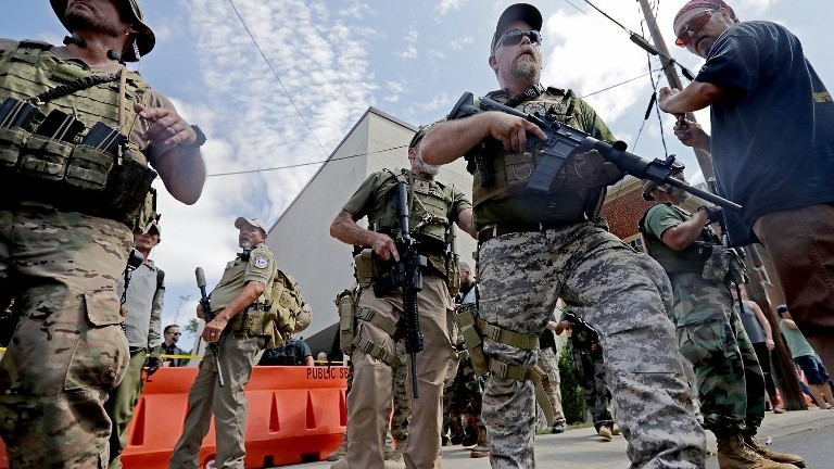 White nationalists, neo-Nazis and members of the 'alt-right' with body armor and combat weapons at the Unite the Right rally on August 12, 2017 in Charlottesville, Virginia. (Chip Somodevilla/Getty Images/AFP)