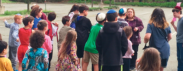 Rabbi Estelle Mills talks to students outside the New Jersey Jewish Academy.